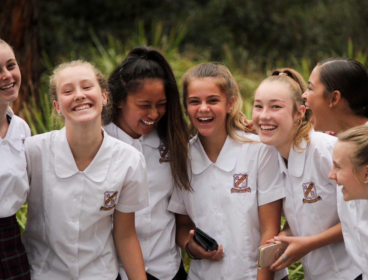 group of girls laughing together